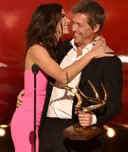 Sandra Bullock and Hugh Grant hugging at Guys Choice Awards