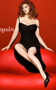 Christina Hendricks big boobs legs and cleavage showing in Esquire magazine photo