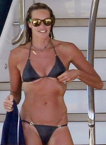 Elle The Body Macpherson 50 years old shows off body in tiny bikini. Boobs escaping from top.