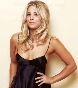 Kaley Cuoco posing in black nightie with no bra