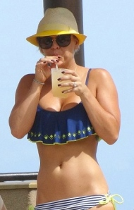 Kaley Cuoco sucking on a straw in bikini and crop top