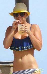 Kaley Cuoco sucking on a straw in bikini and crop top