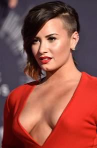 Demi Lovato flaunts major cleavage at VMAs