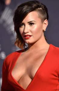 Demi Lovato flaunts major cleavage at VMAs