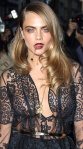 Cara Delevingne wearing see-through black top that shows her boobs