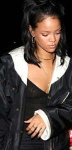Rihanna shows nipple ring through see-through black top