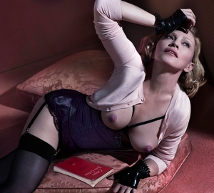 Madonna shows nipples in topless photo for Interview magazine