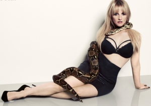 Big Bang Bernadette in sexy Maxim shoot showing big boobs and posing wth a big snake. Melissa Rauch